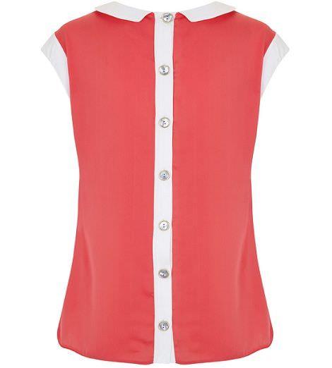 camisa color coral con botones en la espalda